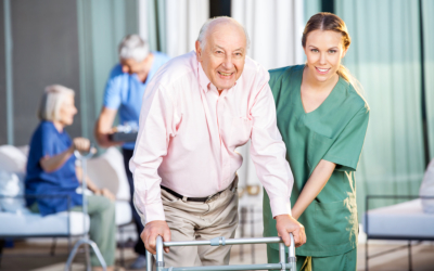 caregiver assisting elderly man to walk