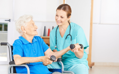 elderly woman doing physical therapy with her caregiver